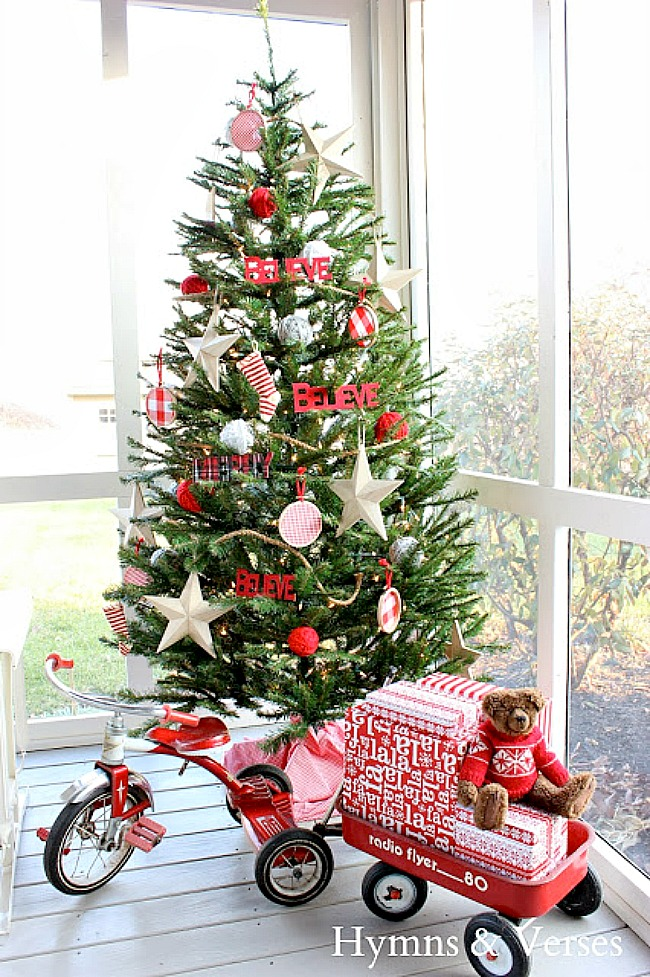 Red and White Christmas Tree on Screen Porch with Vintage Radio Flyer Tricycle and Wagon - Hymns and Verses Blog