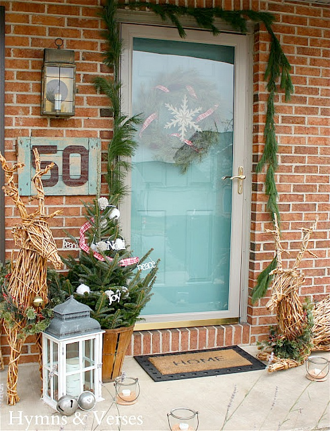 Christmas Porch with Aqua Door and Grapevine Reindeer - Hymns and Verses Blog