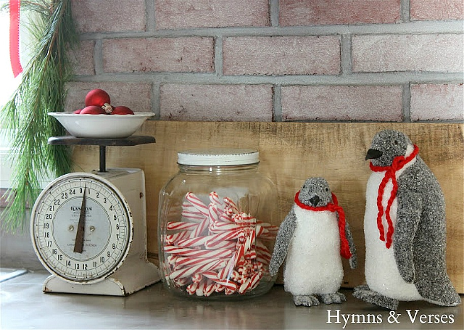 Christmas Vignette with Vintage Scale, Jar of Candy Canes, and Glittery Penguins - Hymns and Verses Blog