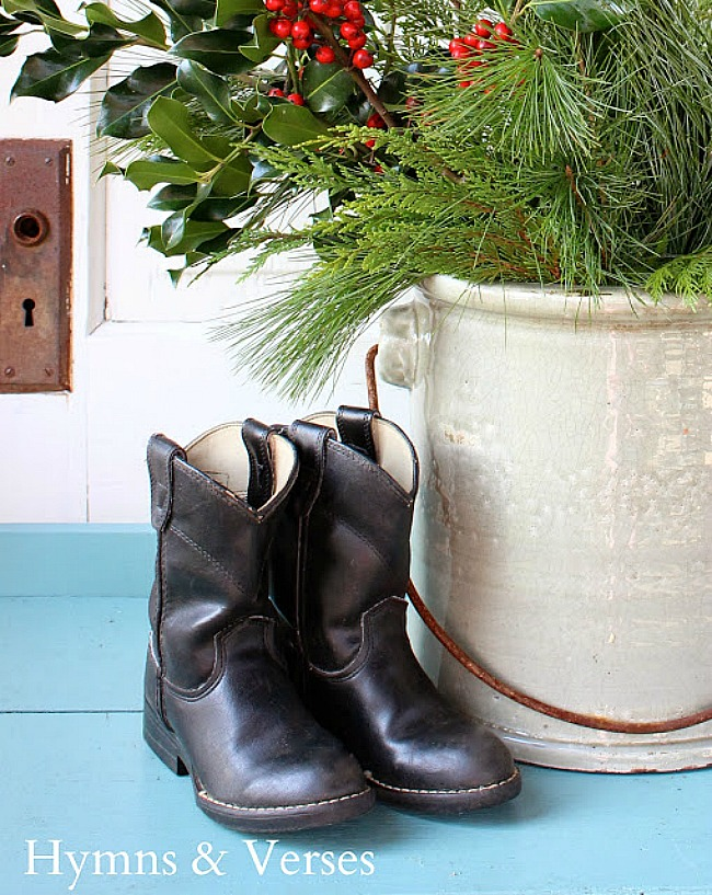 Vintage children's cowboy boots with a crock of Christmas greens - Hymns and Verses Blog