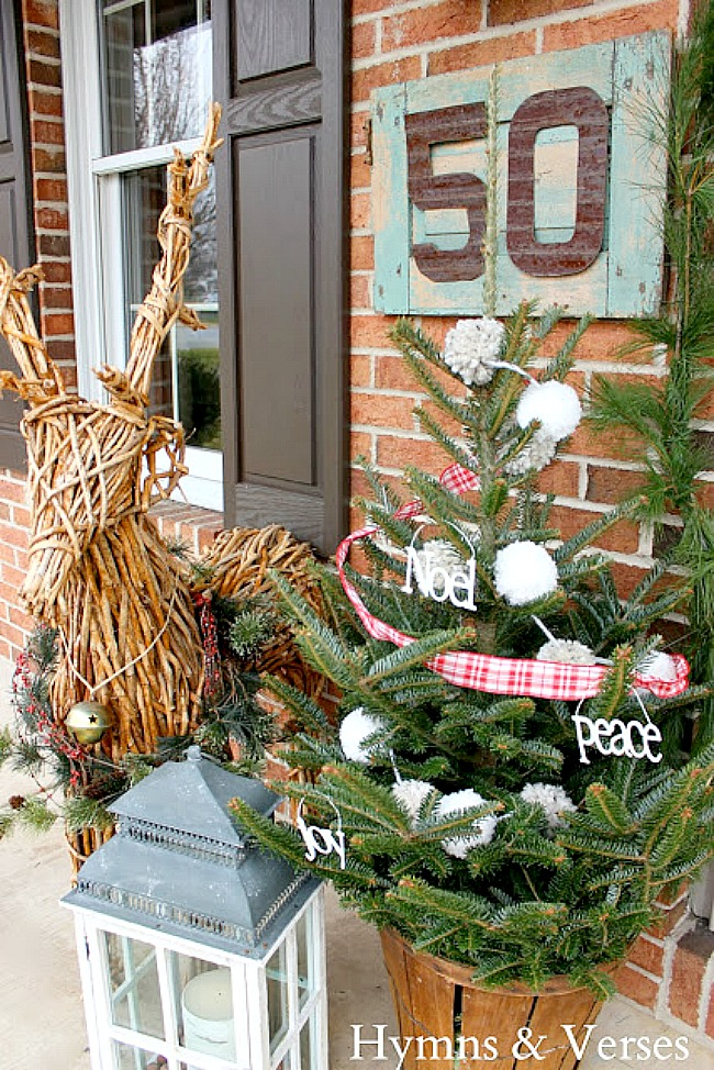 Grapevine reindeer with small Christmas tree on Porch - Hymns and Verses Blog