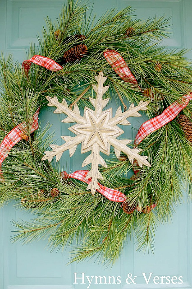 Winter Pine Wreath with Red and White Ribbon and Wooden Snowflake - Hymns and Verses Blog
