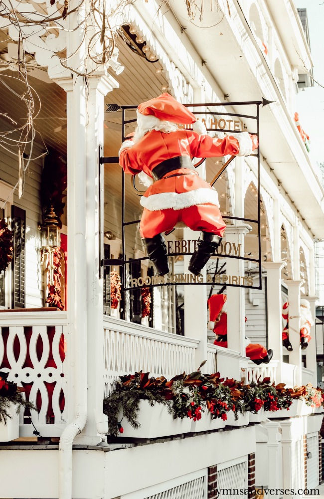 Santa perched on the sign at the Virginia Hotel in Cape May, NJ, at Christmas.