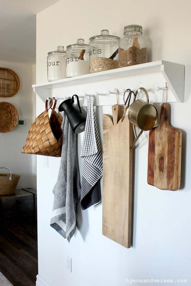 DIY Kitchen Peg Rail Shelf with Cutting Boards, Apron, Basket, and Pitcher